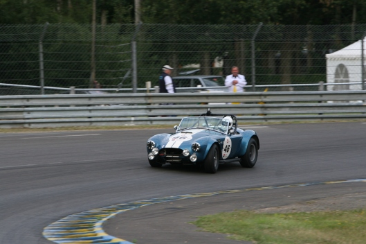 The iconic Cobra Roadster at the Indianapolis corner during Le Mans Classic 2008